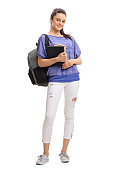 Full length portrait of a teenage student with books isolated on white background