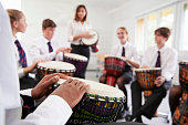 Teenage Students Studying Percussion In Music Class