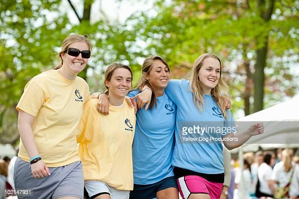 Teenage volunteers walking together at a race