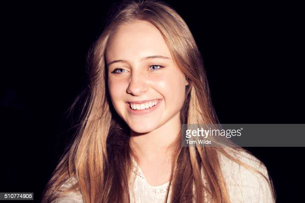 Teenage woman with long blonde hair smiling