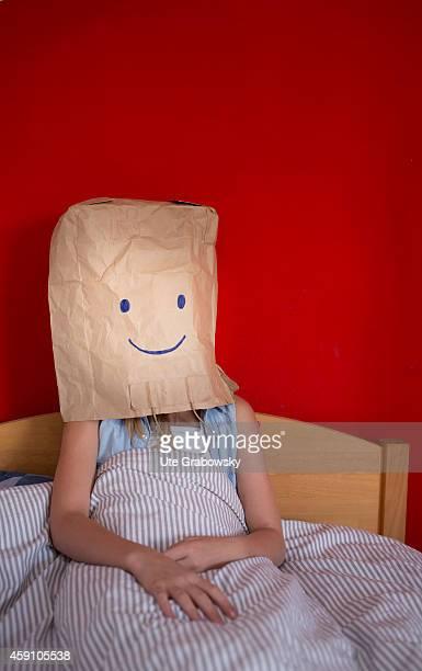 Teenaged girl hiding her feelings behind a paper bag on August 12 in Duelmen Germany Photo by Ute Grabowsky/Photothek via Getty Images