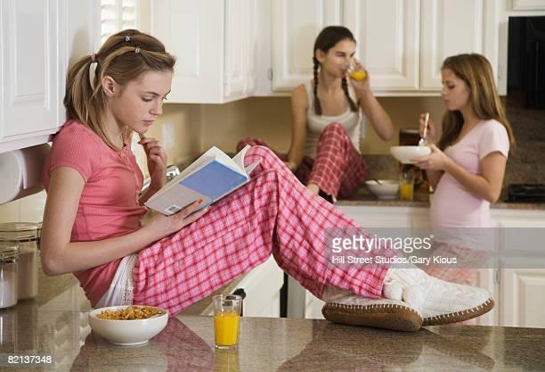 Teenaged girls eating breakfast