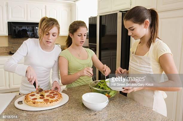 Teenaged girls serving food