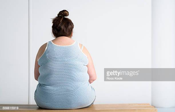 Teenaged overweight girl at bench