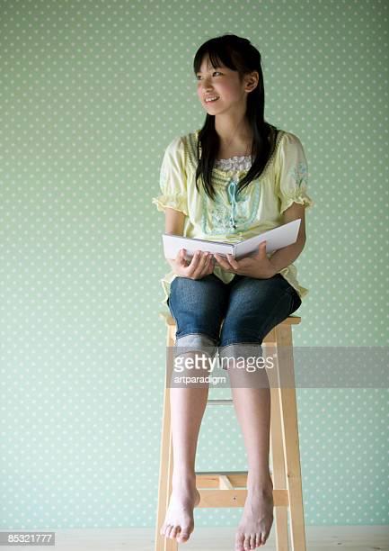 Teenagegirl reading a book