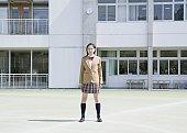Teenagegirl standing on open field