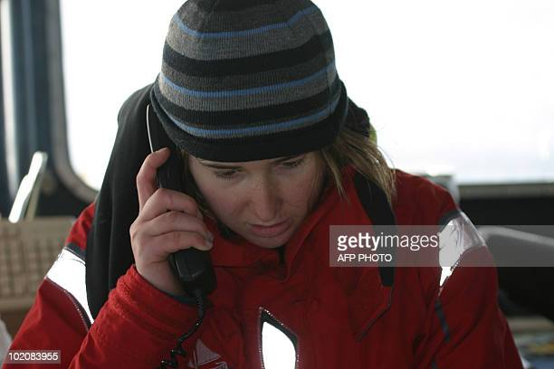 US teenager Abby Sunderland gives a call aboard the French fishing boat 'Ile de La Reunion' after being rescued on June 12 2010 near St Paul island...