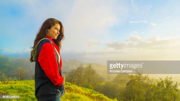 Teenager admiring sunset at mountains of Costa Rica