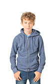 teenager boy standing isolated on white. He is smiling