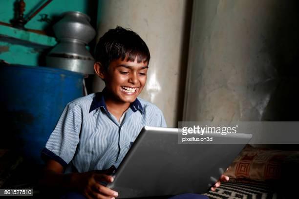 Teenager Boy Using Laptop
