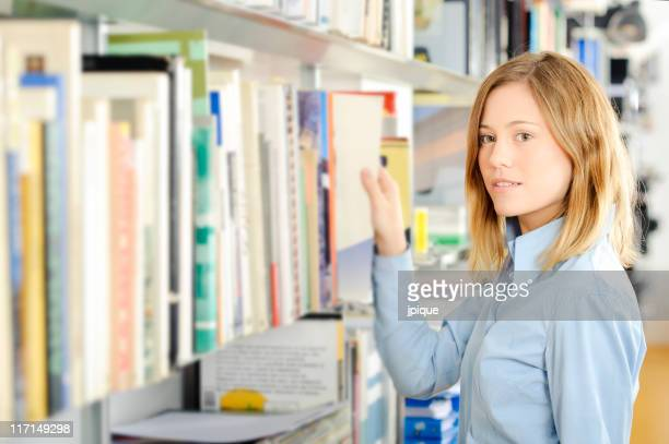 Teenager choosing a book in the library