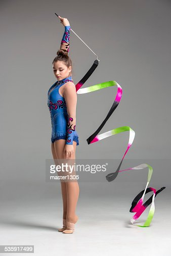 teenager doing gymnastics dance with ribbon : Stock Photo