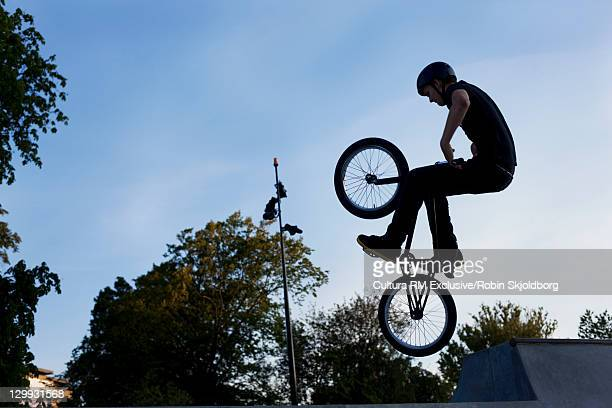 Teenager doing tricks on bmx bike
