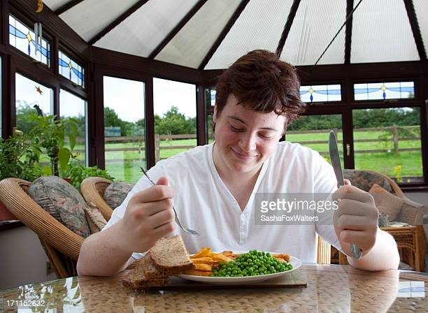 teenager enjoying fries and peas