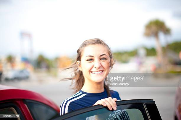 Teenager Getting out of Car