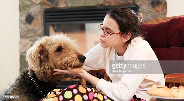 Teenager girl and dog in living room