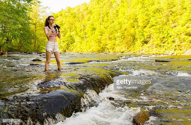 Teenager girl exploring wildlife. Oosterneck Creek, Great Smoky Mountains, Tennessee