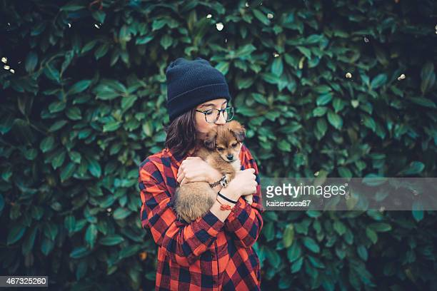Teenager girl holding a cute puppy