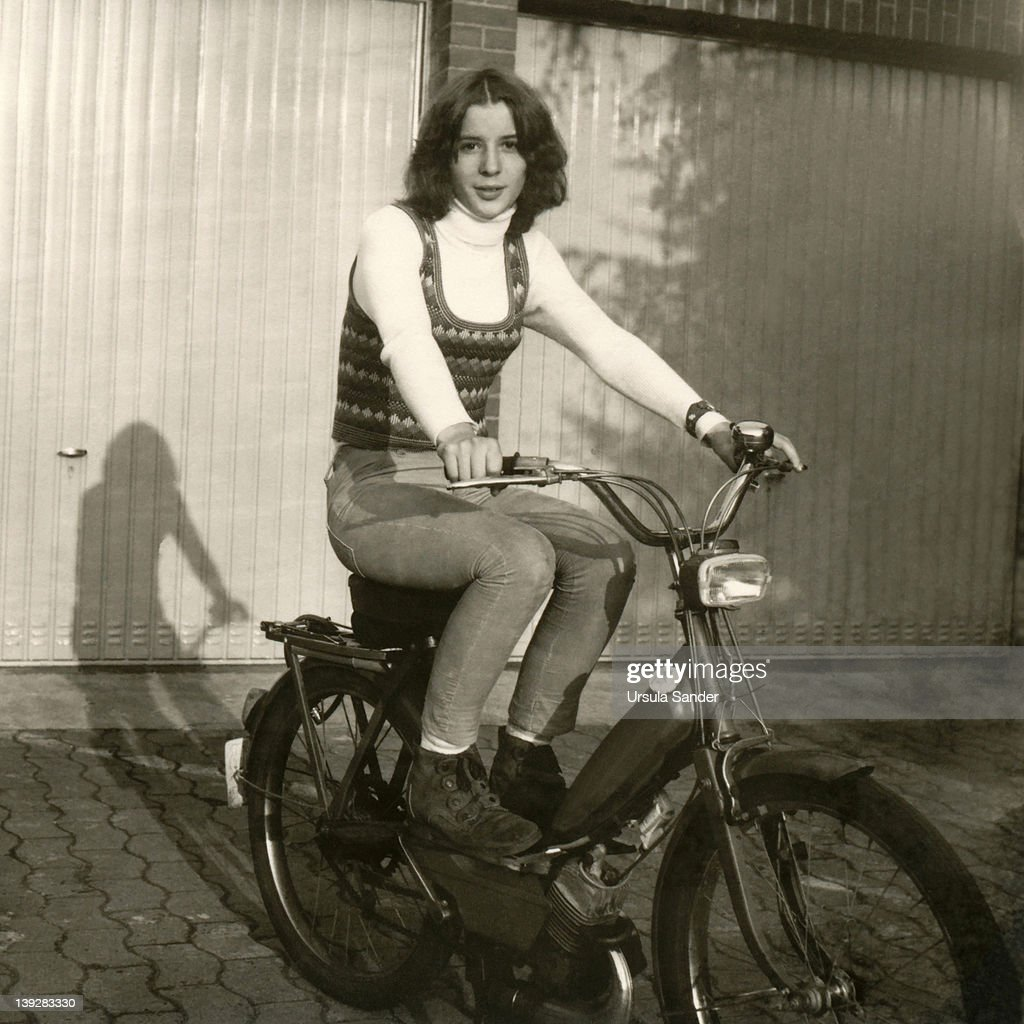 Teenager girl on motorbike