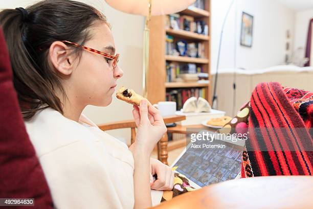 Teenager girl playing with tablet in living room