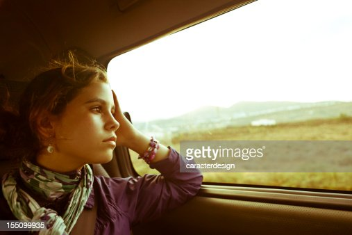 Teenager girl traveling by car