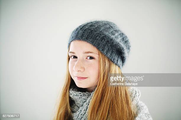 A teenager girl wearing a hat