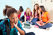 Teens using internet technology and harassing classmate
