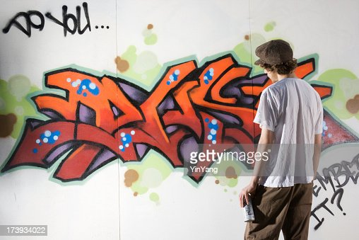stock photo teenager graffiti artist spray painting wall street art. Black Bedroom Furniture Sets. Home Design Ideas