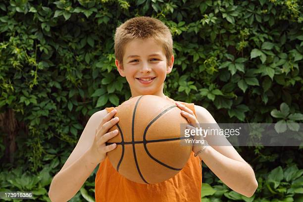 Teenager Holding a Basketball