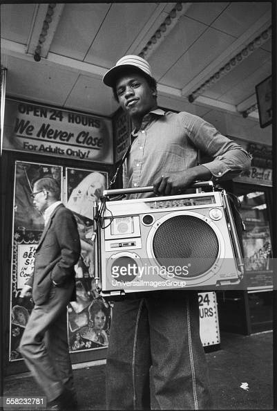A teenager holding his ghetto blaster on 42nd street New York USA 1980