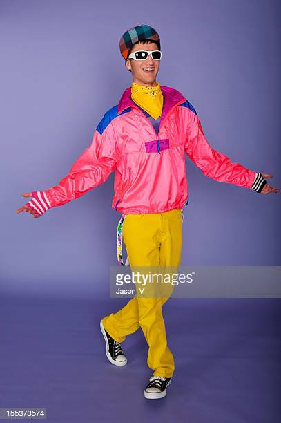 Teenager in 1980s fluorescent pink and yellow with cap