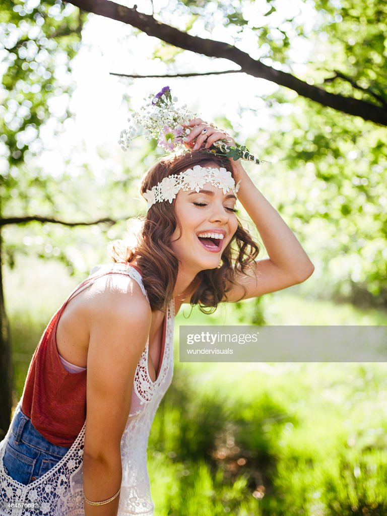 Teenager in boho style laughing happily in a summer park : Stock Photo