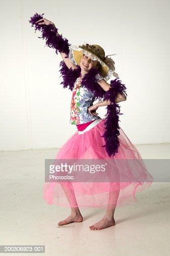 Teenager in fancy dress (14-15) posing in studio