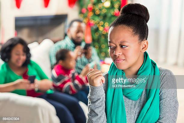 Teenager is upset with family's use of technology at Christmastime