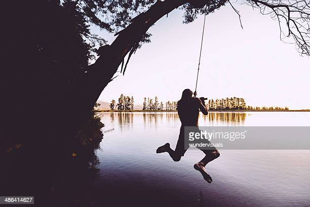 Teenager jumping into the lake