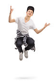 Full length portrait of a teenager jumping isolated on white background