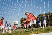 Teenager Kicking Soccer Goal