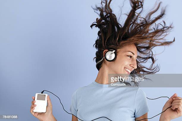 Teenager listening to music on portable device