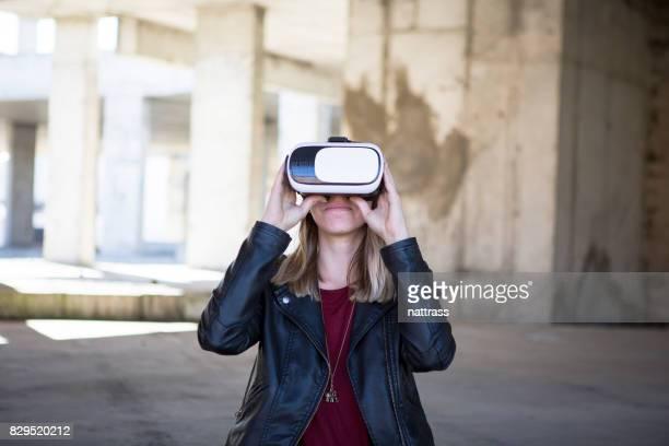 Teenager loving her virtual reality headgear