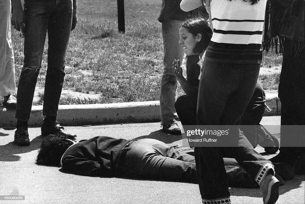 Teenager Mary Ann Vecchio kneels over the body of student Jeffrey Miller during an anti-war demonstration at Kent State University, Ohio, May 4, 1970. Four students, including Miller, were killed (and nine injured) when Ohio National Guard troops fired at some 600 anti-war demonstrators.