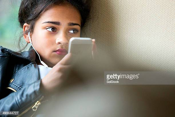 Teenager on her mobile phone