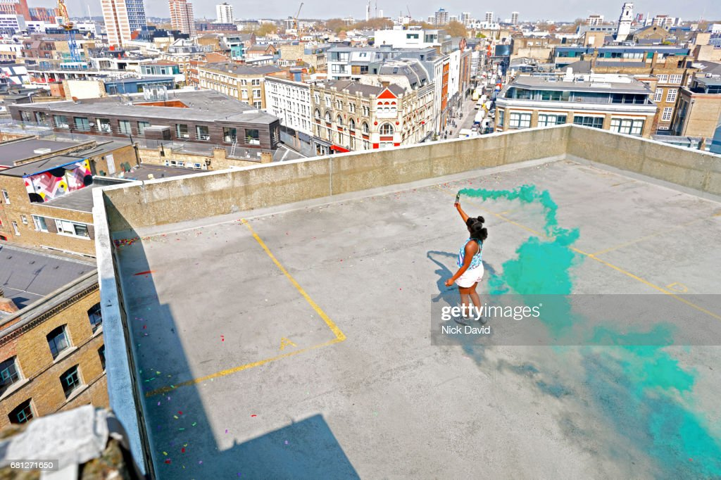 Teenager on London rooftop overlooking the city : Stock Photo