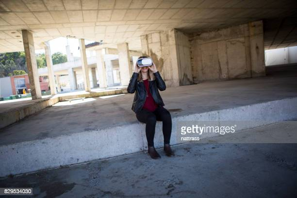 Teenager playing a virtual reality game