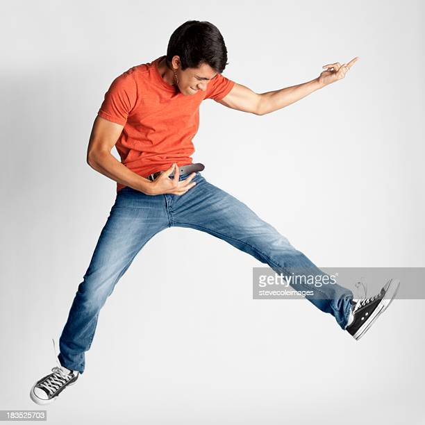 Teenager Playing Air Guitar
