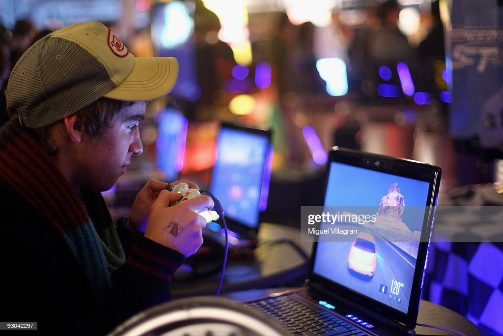 A teenager plays 'Need for speed' at a trade-show booth during the 'Intel Friday Night Game' organized by the Electronic Sports League at Tonhalle on November 13, 2009 in Munich, Germany. Germany's best electronic sports teams meet to play against each other.