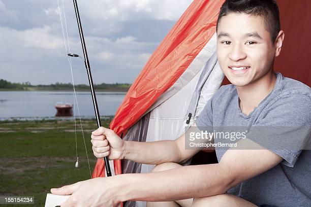 Teenager preparing to fish