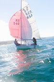 Teenager sailing boat