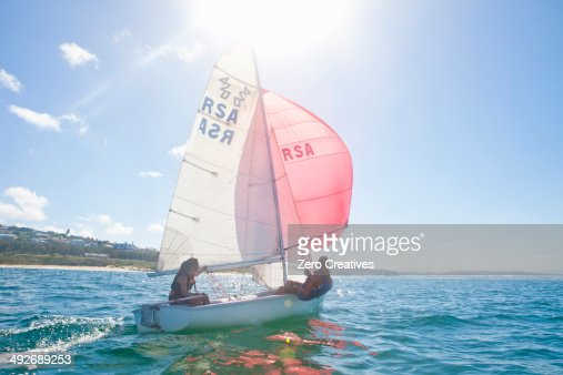 Teenager sailing boat