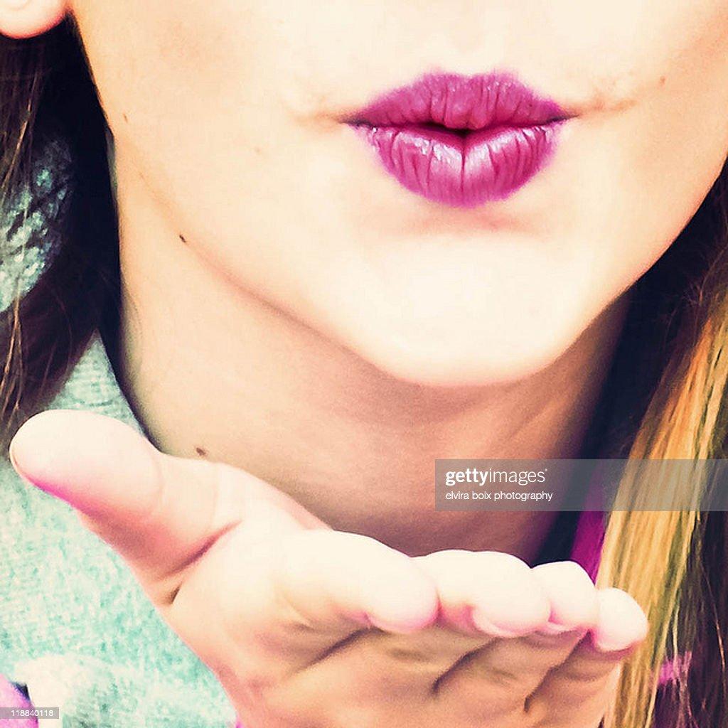 Teenager sending kiss