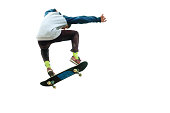A teenager skateboarder jumps an ollie on an isolated white background. The concept of street sports and urban culture.